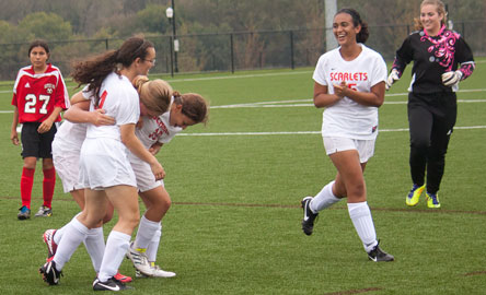 Ridgefield Park celebrating after scoring winning goal.
