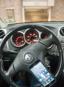 smart-phone-on-steering-whee